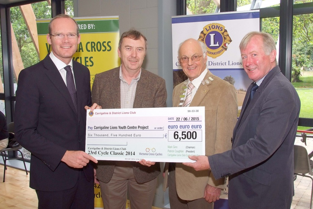Pictured at the Presentation of Cheques from the Proceeds of the Carrigaline & Districts Lions Club Annual Charity Cycle, were from left, The Minister for Agriculture ; Food ; Defence & The Marine, Simon Coveney, TD ; Sean Duggan, Chairman,  Carrigaline Youth Centre Project ; Patrick Coughlan, Club President and Mark Ginn, Cycle Classic Co-Ordinator. (Picture: Adrian O'Herlihy) June 22nd 2015