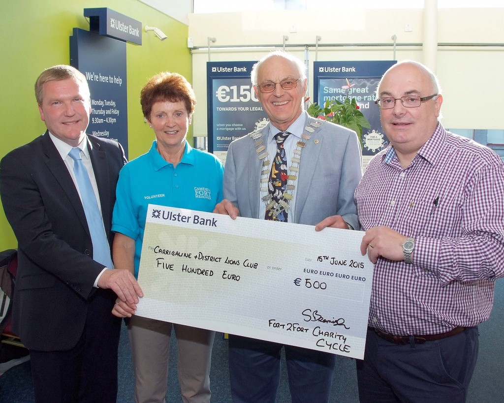 Pictured at the Presentation of cheques from the proceeds of the Fort2Fort Charity Cycle around Cork Harbour, were members of the Carrigaline & District Lions Club, Michael McGrath, TD ; Patrick Coughlan, Club President and Kieran McNamee with Eileen Murphy, Fort2Fort Cycle Committee. (Picture: Adrian O'Herlihy) NO REPRODUCTION FEE  16-6-15