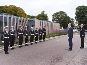 The Minister for Defence ; Marine ; Food & Agriculture, Simon Coveney, TD, pictured with a Guard of Honour from the Irish Navy, before he performed the Official Opening of the Carrigaline Lions Club Youth Centre. (Picture: Adrian O'Herlihy) Sept 18th 2015